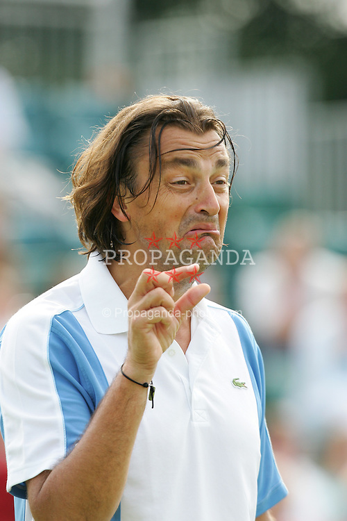 LIVERPOOL, ENGLAND - THURSDAY, JUNE 9th, 2005: Henri Leconte fools around during the Legends Doubles at the Liverbird Developments Liverpool International Tennis Tournament in Calderstones Park. (Pic by Dave Rawcliffe/Propaganda)