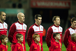 SWANSEA, WALES - Tuesday, March 26, 2013: Wales' James Collins, Gareth Bale and Chris Gunter line up before the 2014 FIFA World Cup Brazil Qualifying Group A match against Croatia at the Liberty Stadium. (Pic by Kieran McManus/Propaganda)