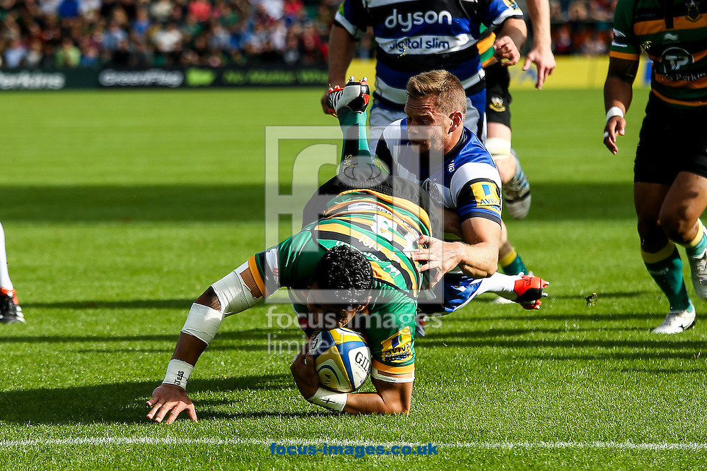 George Pisi of Northampton Saints (centre)  breaks for the line during the Aviva Premiership match at Franklin's Gardens, Northampton<br /> Picture by Andy Kearns/Focus Images Ltd 0781 864 4264<br /> 27/09/2014
