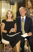 Sir Mark and Lady Weinberg. Pierre Balmain, haute couture presentation. Designed by Oscar de la Renta. Ministere des Affairs Estrangeres. Paris. 9 July 2001. © Copyright Photograph by Dafydd Jones 66 Stockwell Park Rd. London SW9 0DA Tel 020 7733 0108 www.dafjones.com