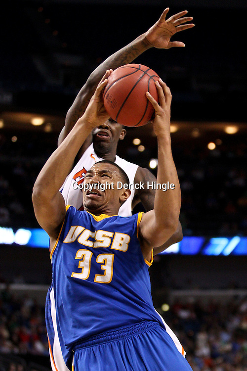 Mar 17, 2011; Tampa, FL, USA; UC Santa Barbara Gauchos guard/forward Orlando Johnson (33) shoots as Florida Gators guard Kenny Boynton (1) defends during second half of the second round of the 2011 NCAA men's basketball tournament at the St. Pete Times Forum. Florida defeated UCSB 79-51.  Mandatory Credit: Derick E. Hingle