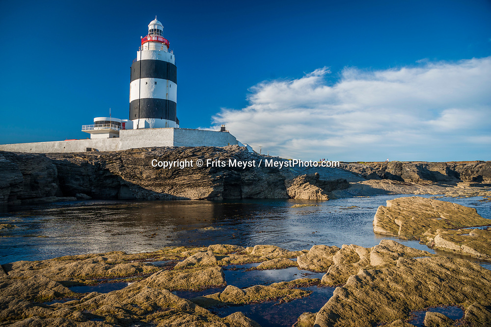 Hook Head, Wexford, Southern Ireland, August 2016. Hook Lighthouse was built 800 years ago, the lighthouse continues to serve its original function and is now the oldest operational lighthouse in the world. A coastal road trip from Kilkenny to Cork via Wexford and Waterford.  Photo by Frits Meyst / MeystPhoto.com