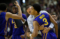LSU head coach Will Wade hugs LSU guard Tremont Waters (3) after Waters hit a three point shot with .7 seconds left against Texas A&M during the second half of an NCAA college basketball game Saturday, Jan. 6, 2018, in College Station, Texas. (AP Photo/Sam Craft)