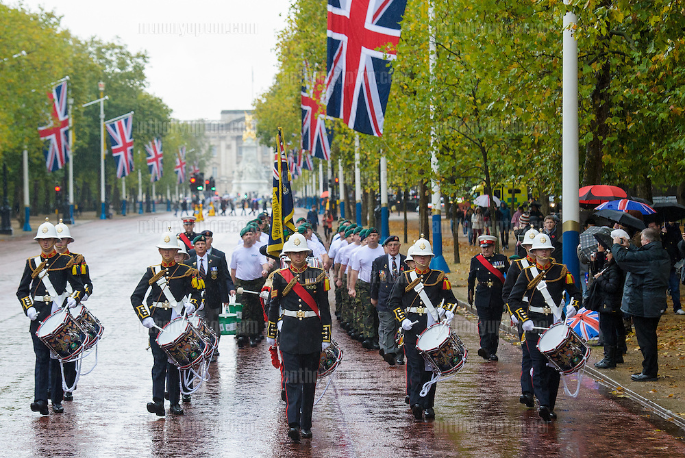 20131109       Copyright image 2013&copy;<br /> Commando 999 members running through central London, during Remembrance weekend, starting from Downing Street, the speedmarch hopes to raise over &pound;1m for The Royal Marines Association by 2014, which is the 350th anniversary of the founding of the Royal Marines, raises funds for war wounded Royal Marines. Commando 999 is made up of former Commandos who are now servingin the UK's emergency services, this includes firefighters, ambulance staff and police officers.<br /> For further info please contact<br /> Alex Rayner - 07789 007232<br /> <br /> For further info please<br /> For photographic enquiries please call Anthony Upton 07973 830 517 or email info@anthonyupton.com <br /> This image is copyright Anthony Upton 2013&copy;.<br /> This image has been supplied by Anthony Upton and must be credited Anthony Upton. The author is asserting his full Moral rights in relation to the publication of this image. All rights reserved. Rights for onward transmission of any image or file is not granted or implied. Changing or deleting Copyright information is illegal as specified in the Copyright, Design and Patents Act 1988. If you are in any way unsure of your right to publish this image please contact Anthony Upton on +44(0)7973 830 517 or email:
