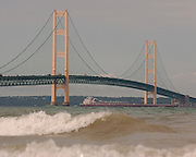 A freighter passes under the Mackinac Bridge where traffic was backed up while emergency personnel  from several different northern Michigan agencies and the Coast Guard search for a woman who reportedly fell or jumped from the bridge.