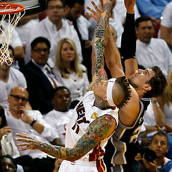 Jun 6, 2013; Miami, FL, USA; Miami Heat power forward Chris Andersen (11) and San Antonio Spurs center Tiago Splitter (22) battle for a rebound in the second quarter during game one of the 2013 NBA Finals at the American Airlines Arena. Mandatory Credit: Derick E. Hingle-USA TODAY Sports