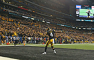 Iowa Hawkeyes wide receiver Tevaun Smith (4) celebrates after his 85-yard touchdown reception during the fourth quarter of the 2015 Big Ten Football Championship Game at Lucas Oil Stadium in Indianapolis, Ind. on Saturday, Dec. 5, 2015.
