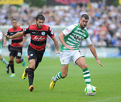 Queen Park Rangers' Charlie Austin chases down Yeovil Town's Daniel Seaborne to gain the ball back. - Photo mandatory by-line: Alex James/JMP - Tel: Mobile: 07966 386802 21/09/2013 - SPORT - FOOTBALL - Huish Park - Yeovil - Yeovil Town V Queens Park Rangers - Sky Bet Championship