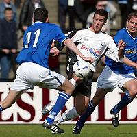 Ayr Utd v St Johnstone...24.04.04  <br />Stuart Kean breaks through Stuart Taylor and Paul Bernard<br /><br />Picture by Graeme Hart.<br />Copyright Perthshire Picture Agency<br />Tel: 01738 623350  Mobile: 07990 594431