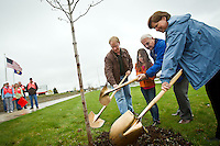 """Rheana shovels dirt onto a freshly planted tree with Post Falls Mayor Clay Larkin during an Earth Day event Thursday, April 22, 2010 in front of Kimball Office in Post Falls, Idaho. Rheana came to work with me for the """"Bring Your Daughter to Work Day"""" after asking to come for the past two years."""