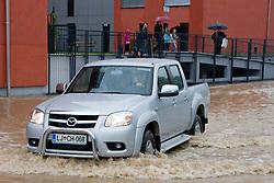 Car driving through the water after heavy rain on September 18, 2010, in Ljubljana, Slovenia. (Photo by Matic Klansek Velej / Sportida)