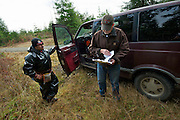 Jim Furabotten -Checks documentation of salal pickers. They had legal permits. - Olympic Peninsula, WA State