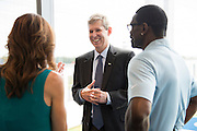 "Frisco ISD Superintendent Dr. Jeremy Lyon visits with Dallas Cowboys Executive Vice President / Chief Brand Officer Charlotte Jones Anderson and NFL Hall of Fame inductee Michael Irvin in the new Dallas Cowboys headquarters in Frisco, Texas on August 23, 2016. ""CREDIT: Cooper Neill for The Wall Street Journal""<br /> TX HS Football sponsorships"