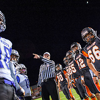110813       Cable Hoover<br /> <br /> Referee Pete Hamilton gives directions to the captains of the Gallup Bengals and Miyamura Patriots as they prepare to face off in the final game of the season Friday at Public School Stadium.
