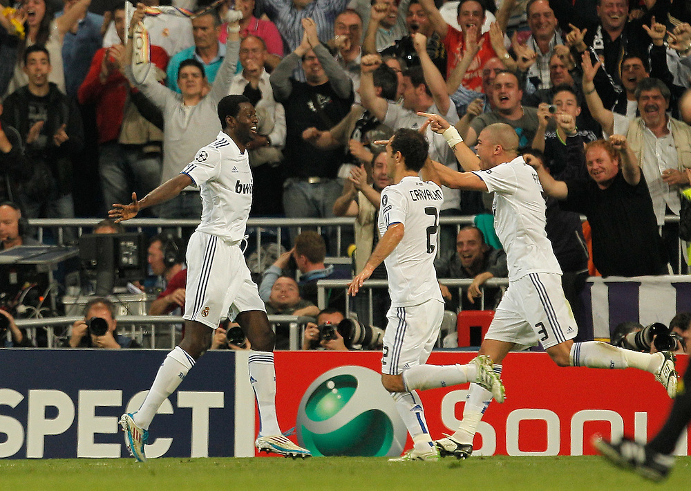 Real Madrid's Emmanuel Adebayor from Togo, left, reacts after scoring against Tottenham Hotspur with fellow team members Ricardo Carvalho from Portugal, center, and Pepe from Portugal, right, during a quarter final, 1st leg Champions League soccer match at the Santiago Bernabeu stadium in Madrid, Tuesday, April 5, 2011.