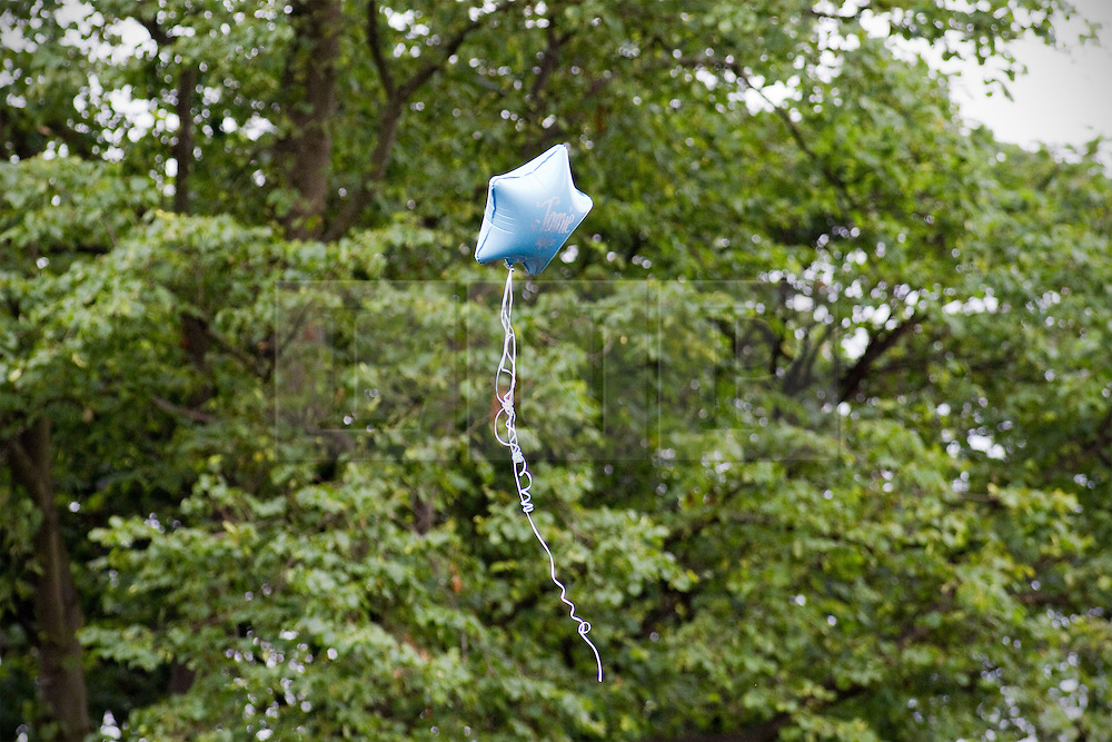 © Licensed to London News Pictures. 19/07/2012. Oldham , UK . The funeral of 2 year old Jamie Heaton , who was killed in a blast in his home on 26/06/2012 . A balloon with the name JAMIE printed on it is released in to the sky by mourners towards the end of the service . Photo credit : Joel Goodman/LNP
