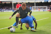 Peterborough United midfielder Siriki Dembele (10) and Portsmouth midfielder Tom Naylor (7) wrestle in the box during the EFL Sky Bet League 1 match between Peterborough United and Portsmouth at London Road, Peterborough, England on 15 September 2018.