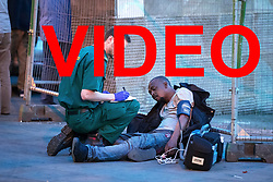 VIDEO available here: https://we.tl/zvcu9ewaJi<br /> <br /> © Licensed to London News Pictures . 07/04/2017 . Manchester , UK . A paramedic tends to a man slumped on the ground in Piccadilly Gardens . Greater Manchester Police have authorised dispersal powers and say they will ban people from the city centre for 48 hours , this evening (7th April 2017) , in order to tackle alcohol and spice abuse . Photo credit : Joel Goodman/LNP