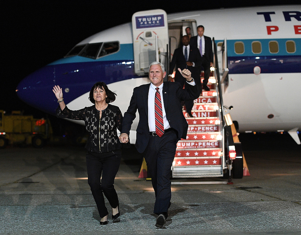 MOON TOWNSHIP, PA - NOVEMBER 3: Republican Vice Presidential candidate Mike Pence and his wife Karen Pence wave to the crowd as they arrive at a campaign rally at Atlantic Aviation on November 3, 2016 in Moon Township, Pennsylvania (Photo Credit: Justin Berl)