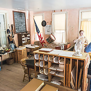 A guide in period costume explains to a visitor the history of the police station in Harpers Ferry, West Virginia.