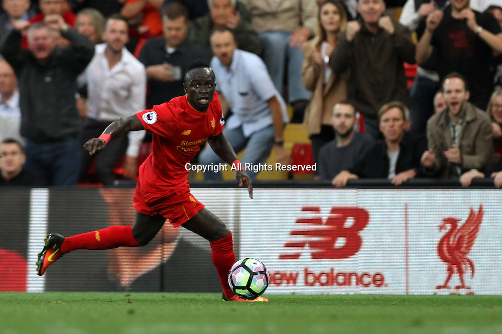 10.09.2016. Anfield, Liverpool, England. Premier League Football. Liverpool versus Leicester. Sadio Mane of Liverpoolis skips past the sliding tackle by Kasper Schmeichel, Leicester City goalkeeper and lays on the 4th and final goal for Roberto Firmino