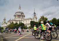 Riders cycle pass St Pauls as they approach a festival zone as part of the Prudential RideLondon FreeCycle 29/07/2017<br />