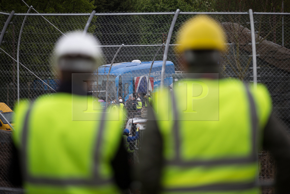 © Licensed to London News Pictures . 06/05/2015 . Chester , UK . Press are held back 100m as David Cameron exits the Conservative Party battle bus , during a tightly managed visit by the Conservative Party Leader David Cameron to a building site for an extension at Chester Zoo on the final day of the election campaign . Photo credit : Joel Goodman/LNP