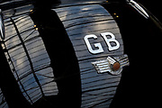 Detail of a GB car badge on the back of a British Morris Minor vintage car, on 29th June 2017, in Greenwich, London, England.