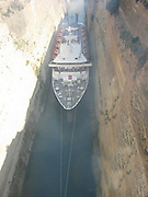 The Corinth Canal is a canal that connects the Gulf of Corinth with the Saronic Gulf in the Aegean Sea. It saves the 700-kilometre (430 mi) journey around the Peloponnese, it is too narrow for modern ocean freighters as it can only accommodate ships of a width of up to 16.5 metres (54 ft) and a depth of 7.3 metres (24 ft). Ships can only pass through the canal one at a time on a one-way system. Larger ships have to be towed by tugs. The canal is nowadays mostly used by tourist ships; 11,000 ships per year travel through the waterway<br /> ©Corinth Canal/Exclusivepix