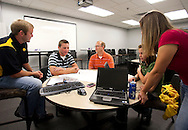 UI graduate and former intern Tyler Kleene, UI student and current intern Damian Long, Pierce Stark, UI student and current intern Leah Zmolek and UI graduate and former intern Cassidy Whitmore at Genencor in Cedar Rapids on Friday July 24, 2009.  (Stephen Mally/Freelance)