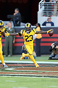 Los Angeles Rams cornerback Nickell Robey-Coleman (23) waves his arms as he runs through the end zone after intercepting a first quarter pass on the San Francisco 49ers first play from scrimmage and running it down to the 49ers 3 yard line during the 2017 NFL week 3 regular season football game against the against the San Francisco 49ers, Thursday, Sept. 21, 2017 in Santa Clara, Calif. The Rams won the game 41-39. (©Paul Anthony Spinelli)