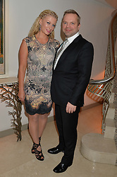 JOHN & CARRIE HART at the Fortune Forum Club dinner in the presence of HSH Prince Albert II of Monaco held at The Dorchester, Park Lane, London on 15th January 2014.