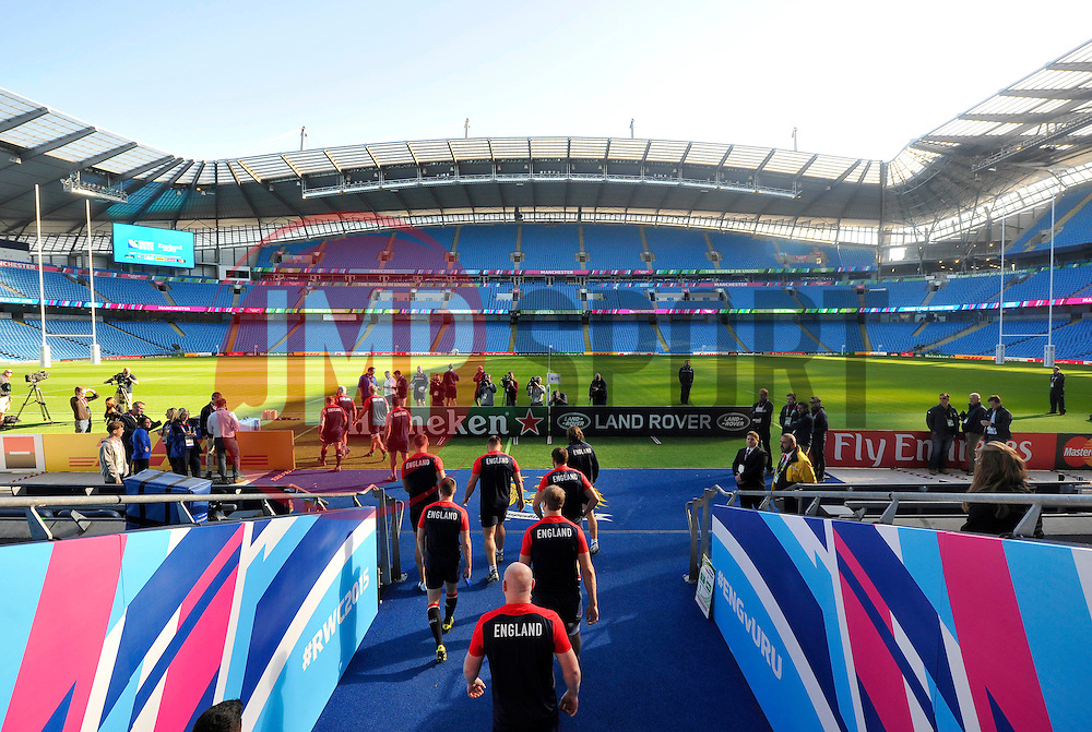 The England team walk onto the Manchester City Stadium field at the start of the session - Mandatory byline: Patrick Khachfe/JMP - 07966 386802 - 09/10/2015 - RUGBY UNION - Manchester City Stadium - Manchester, England - England Captain's Run - Rugby World Cup 2015.