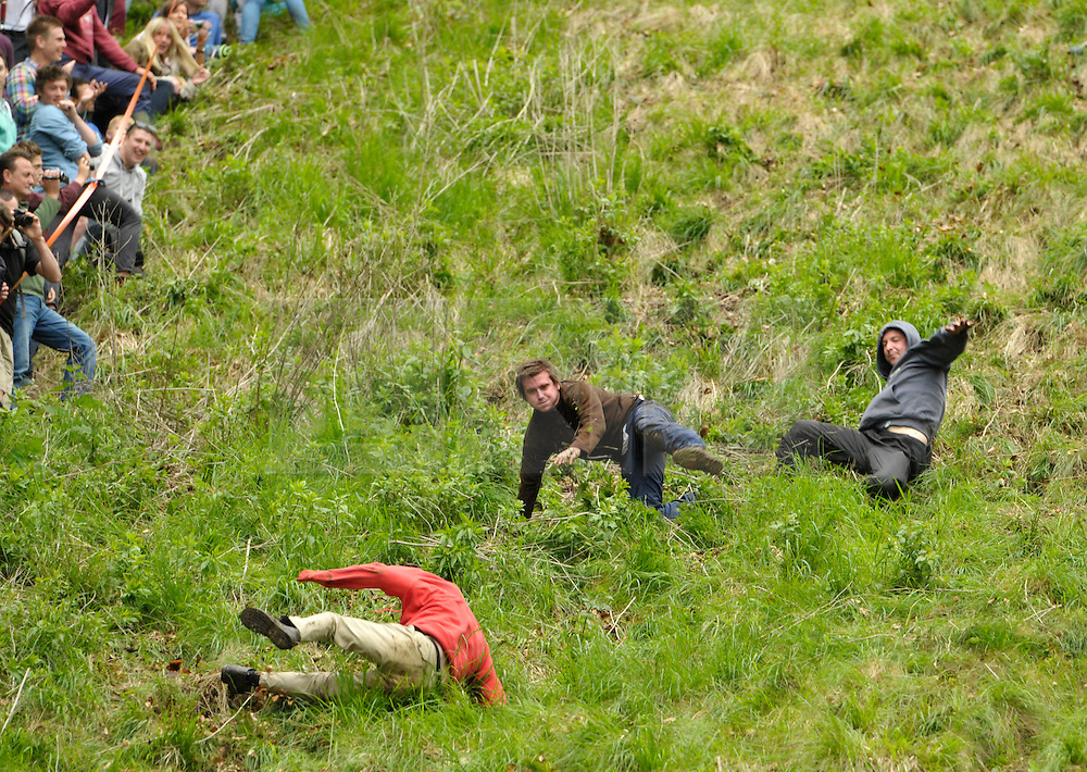 &copy; Licensed to London News Pictures. 26/05/2014; Brockworth, Gloucestershire, UK.  The annual custom of Cheese Rolling down Cooper's Hill, with participants chasing a double Gloucestershire cheese down a very steep slope.<br /> Photo credit: Simon Chapman/LNP
