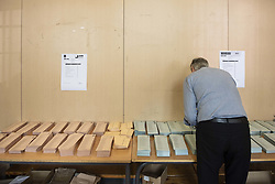 May 26, 2019 - Madrid, Spain - A man seen preparing his ballot at a polling station during the Spanish local, regional and European parliamentary elections in Madrid. (Credit Image: © Miguel Candela/SOPA Images via ZUMA Wire)