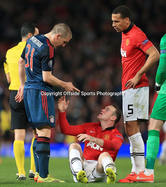 1st April 2014 - UEFA Champions League - Quarter-Final (1st Leg) - Manchester United v Bayern Munich - Bastian Schweinsteiger of Bayern wags his finger at Wayne Rooney of Man Utd after being sent off - Photo: Simon Stacpoole / Offside.