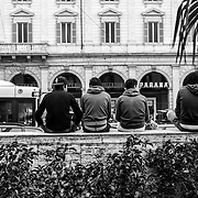 Rome, boys , including many minors mostly Egyptians, North Africans, meet themselves daily, sitting on a low wall at the entrance of Termini Train Station.