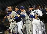 Texas Rangers' catcher Gerald Laird, left, is restrained by Seattle Mariners' Manager John McLaren, second from left, after Richie Sexson charged pitcher Kason Gabbard in the fourth inning of a MLB baseball game in Seattle on Thursday May 8, 2008. Sexson was ejected after the incident. (AP Photo/Kevin P. Casey)
