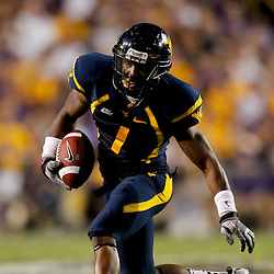 Sep 25, 2010; Baton Rouge, LA, USA; West Virginia Mountaineers wide receiver Tavon Austin (1) runs after a catch against the LSU Tigers during the second half at Tiger Stadium. LSU defeated West Virginia 20-14.  Mandatory Credit: Derick E. Hingle