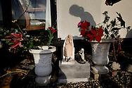 UNITED KINGDOM, Basildon: Sacred statuettes outside a caravan  on the traveller settlement at Dale Farm near Basildon, Essex, south east England, on September 15, 2011. © Christian Minelli.