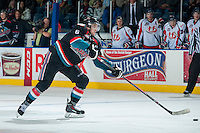 KELOWNA, CANADA, OCTOBER 16 -  Mitchell Wheaton #6 of the Kelowna Rockets takes a shot on net of the Lethbridge Hurricanes on Wednesday, October 16, 2013 at Prospera Place in Kelowna, British Columbia (photo by Marissa Baecker/Getty Images)***Local Caption***