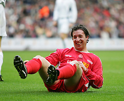 LIVERPOOL, ENGLAND - SUNDAY MARCH 27th 2005: Liverpool Legends' Robbie Fowler ends up on the floor against the Celebrity XI during the Tsunami Soccer Aid match at Anfield. (Pic by David Rawcliffe/Propaganda)