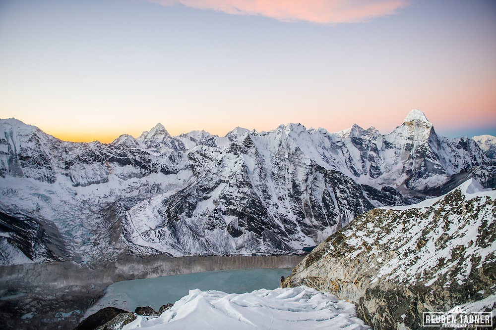 Dawn breaks over the Himalayas. Ama Dablam to the right and the Imja glacier Lake at the bottom centre.