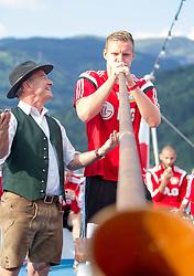 17.07.2014, Zeller See, Zell am See, AUT, Bayer 04 Leverkusen Trainingslager, im Bild Bernd Leno (Bayer 04 Leverkusen) blässt ein Alphorn // Bernd Leno (Bayer 04 Leverkusen) during a Boattrip of the German Bundesliga Club Bayer 04 Leverkusen at the Lake Zell, Zell am See, Austria on 2014/07/17. EXPA Pictures © 2014, PhotoCredit: EXPA/ JFK
