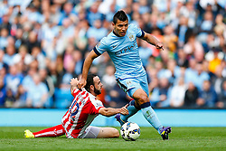 Sergio Aguero of Manchester City is challenged by Marc Wilson of Stoke who appears to grab his leg - Photo mandatory by-line: Rogan Thomson/JMP - 07966 386802 - 30/08/2014 - SPORT - FOOTBALL - Manchester, England - Etihad Stadium - Manchester City v Stoke City - Barclays Premier League.