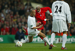 CARDIFF, WALES - Sunday, March 2, 2003: Liverpool's El-Hadji Diouf shoots at the Manchester United goal despite the attentions of Mikael Silvestre during the Football League Cup Final at the Millennium Stadium. (Pic by David Rawcliffe/Propaganda)