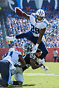 Wesley Hitt<br /> PO Box 1891<br /> Fayetteville, AR 72702<br /> wesley@hittphotography.com<br /> Date Taken:  September 10, 2017<br /> Location:  Nissan Stadium in Nashville, TN<br /> <br /> Category:  Action<br /> <br /> <br /> <br /> NASHVILLE, TN - SEPTEMBER 10:  DeMarco Murray #29 of the Tennessee Titans runs the ball and jumps over and knocks the helmet off of David Amerson #29 of the Oakland Raiders at Nissan Stadium on September 10, 2017 in Nashville, Tennessee.  The Raiders defeated the Titans 26-16.