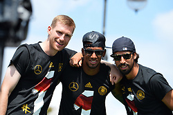 15.07.2014, Brandenburger Tor, Berlin, GER, FIFA WM, Empfang der Weltmeister in Deutschland, Finale, im Bild Per Mertesacker (GER) li, Jerome Boateng (GER) Mitte und Sami Khedira (GER) re. // during Celebration of Team Germany for Champion of the FIFA Worldcup Brazil 2014 at the Brandenburger Tor in Berlin, Germany on 2014/07/15. EXPA Pictures © 2014, PhotoCredit: EXPA/ Eibner-Pressefoto/ Harzer  *****ATTENTION - OUT of GER*****