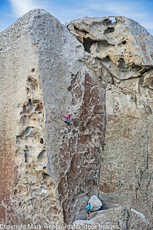 Mandi Eldridge rock climbing a route called Tribal Boundaries which is rated 5,10 and located on Flaming Rock at the City Of Rocks National Reserve near the town of Almo in southern Idaho