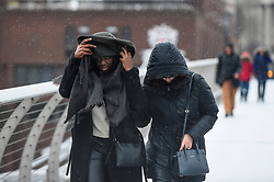 © Licensed to London News Pictures. 09/02/2020. LONDON, UK.  Women brave the elements on Millennium Bridge as Storm Ciara brings strong winds and rain to much of the UK.  The Met Office has issued yellow and amber warnings for the country.  Photo credit: Stephen Chung/LNP